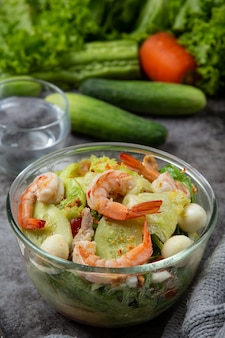 Caesar prawn salad with delicious shrimp healthy food concept.