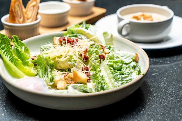 Caesar salad bowl with egg