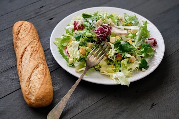 Caesar salad and bread, top view