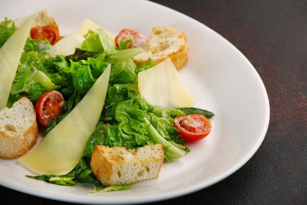 Caesar salad close up. chicken caesar salad with parmesan cheese.