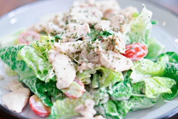 Caesar salad in a dish is a menu in the restaurant.