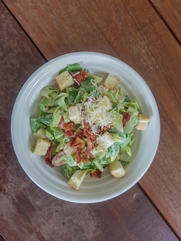 Caesar salad in a dish with copy space is a menu in the restaurant.