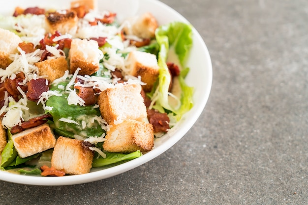 Caesar salad on table
