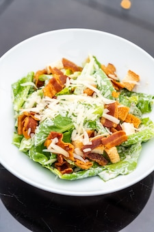 Caesar salad on white plate