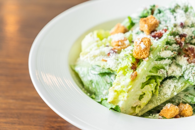 Caesar salad on white plate