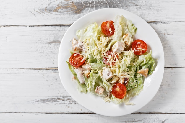 Caesar salad with chicken, croutons, quail eggs and cherry tomatoes