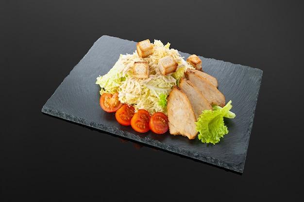 Caesar salad with chicken fillet
