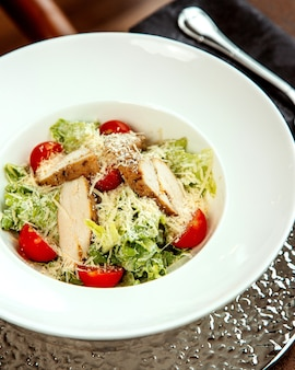 Caesar salad with chicken and grated parmesan