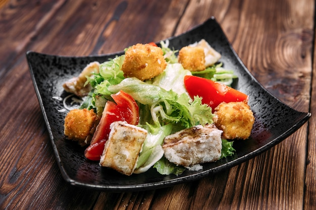 Caesar salad with fried tofu and deep-fried cheese