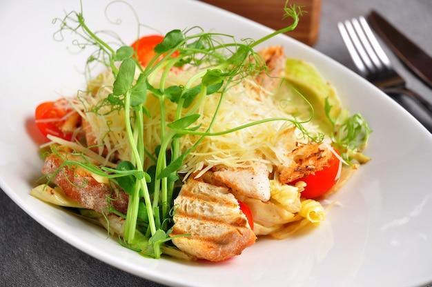 Caesar salad with micro greenery. alternative bright feed
