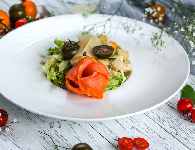 Caesar salad with salmon and cherry tomato