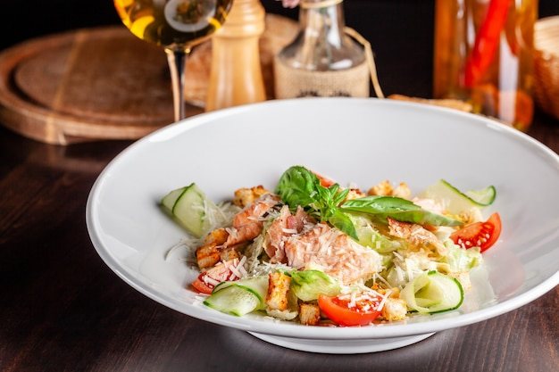 Caesar salad with salmon.