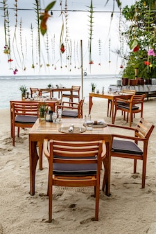 Cafe by the sea. wooden furniture and decorations.