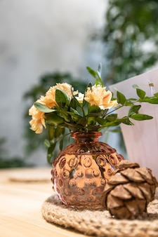 Cafe or coffee shop interior with flowers and green leaves in vase neutral colors simple style
