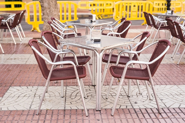 Cafe, coffee shop, tavern and restaurant concept - outdoor street cafe tables ready for service.