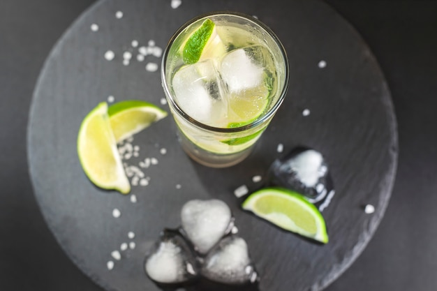 Caipirinha cocktail with ice and lime.