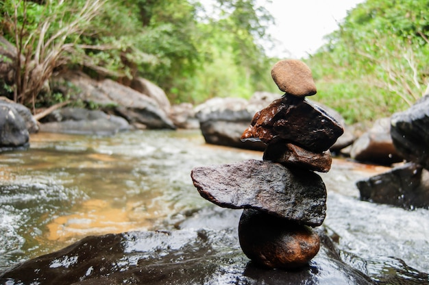 Cairn on river in morning