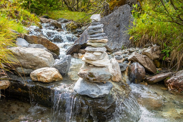 Cairn on a river in vanoise national park valley