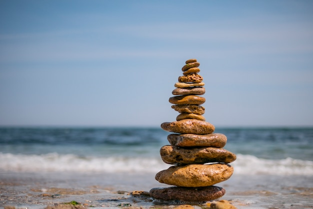 Cairn on sea background. pyramid