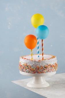 Cake and balloons arrangement