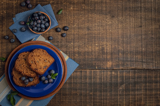 Cake and blueberries with copy space