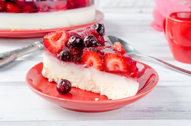 Cake or cheesecake with berries and a cup of coffee