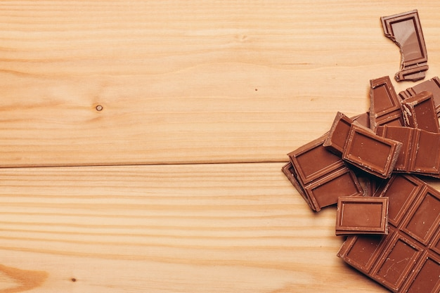 Cake and chocolate bar wooden background image texture