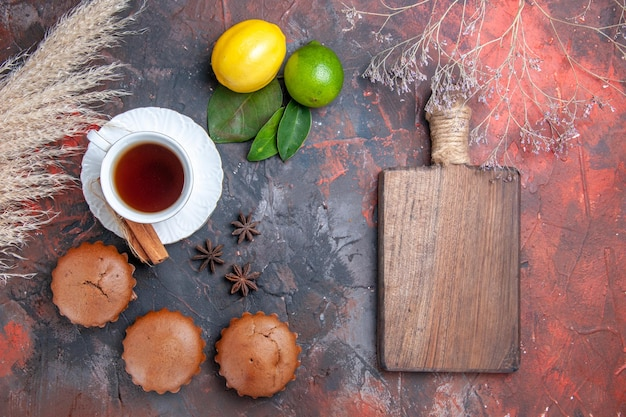 Cake cupcakes a cup of tea with cinnamon wheat ears cutting board star anise