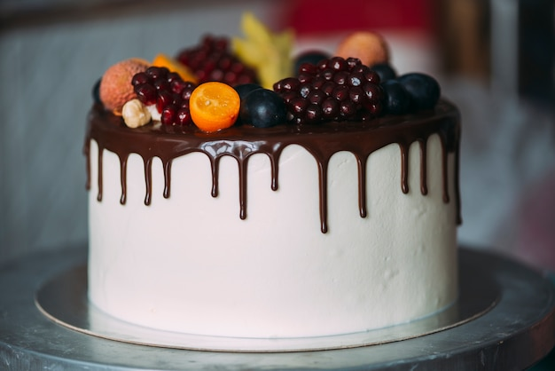 Cake decorated with berries and chocolate
