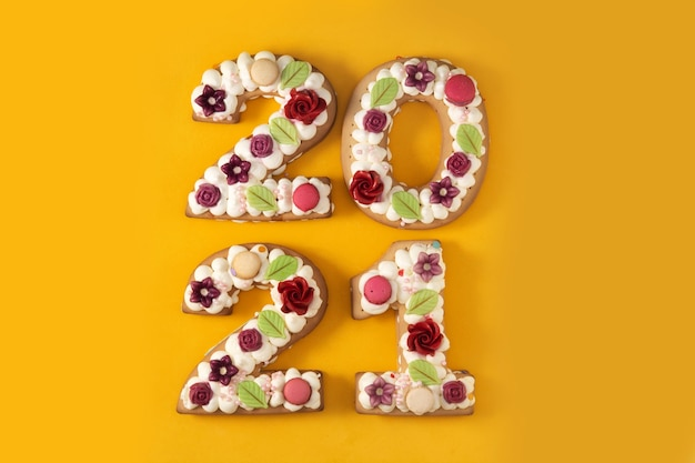 Cake decorated with flowers isolated on yellow background
