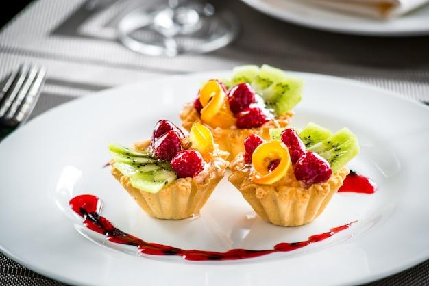 Cake dessert fruity berry cream on a plate