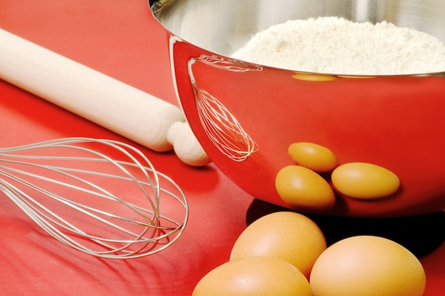 Cake ingredients and confectioner utensils