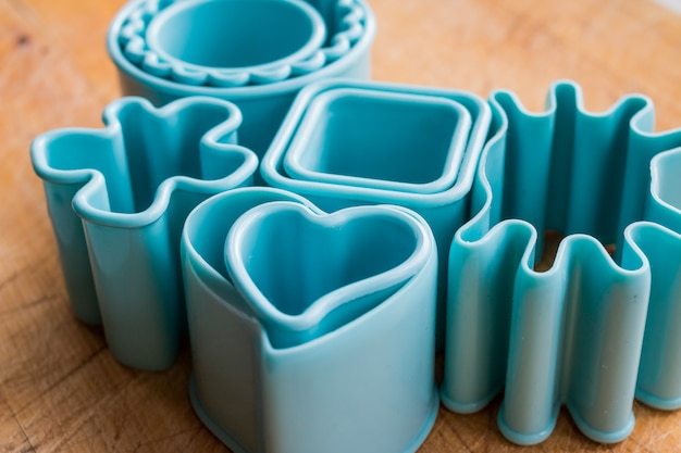 Cake molds isolated on a wooden background. set of forms for cookie cutters for holiday baking.