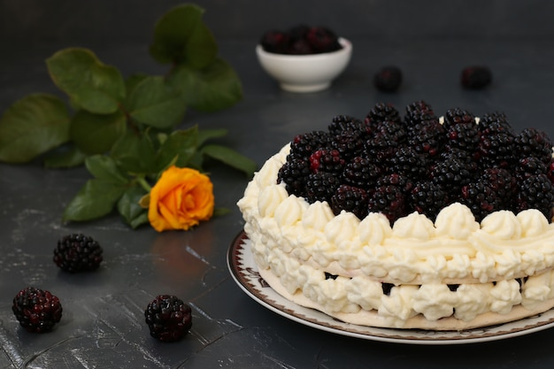 Cake pavlova with blackberries and whipped cream