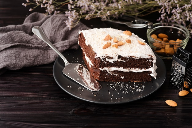Cake on plate with almonds and flowers