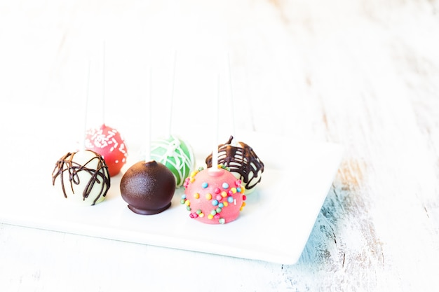Cake pops close up on the white plate