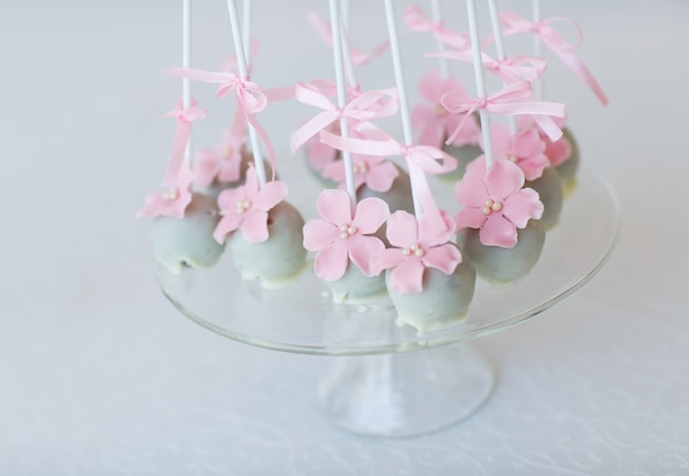 Cake pops on glass on glass
