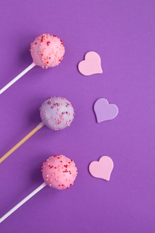 Cake pops with sprinkles and hearts