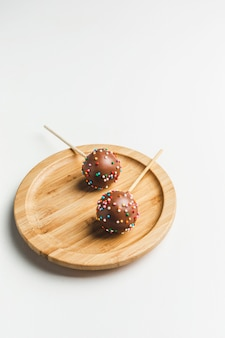 Cake pops on wooden stand