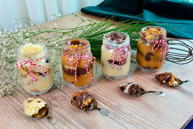 Cake pot dessert chocolate and nuts sweet on a wooden rustic table