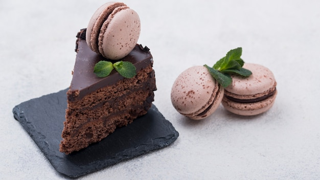 Cake on slate with macarons and mint