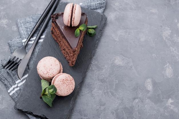 Cake on slate with mint and macarons