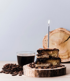 Cake slice with candle and coffee