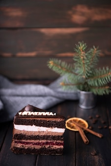 Cake slice with cinnamon and coffee beans