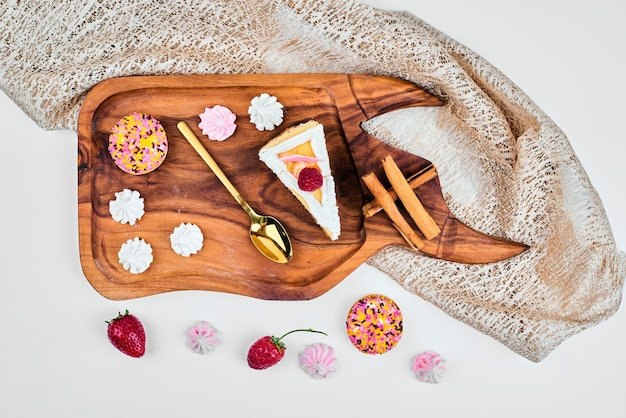Cake slice on a wooden board.