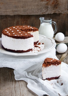 Cake souffle with cream and chocolate cookie crumbs