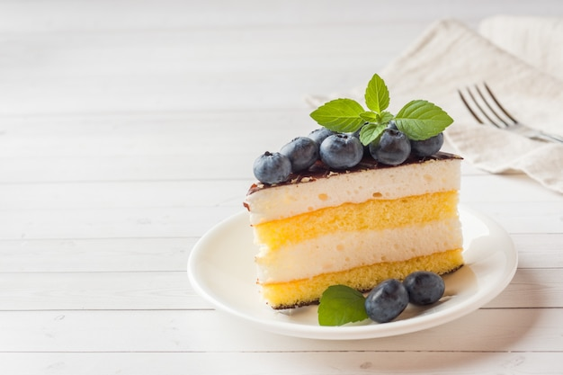 Cake of a souffle with glaze and fresh blueberries. copy space