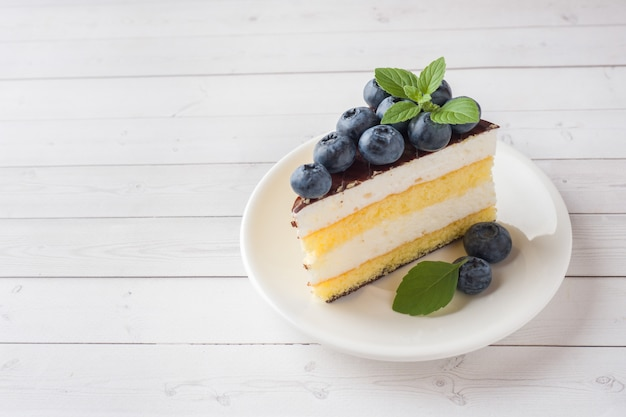 Cake of a souffle with glaze and fresh blueberries