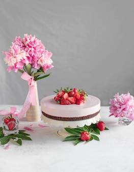 Cake on a stand with strawberries