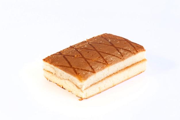 Cake on white wall